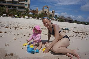 Capri and Mom playing in the sand