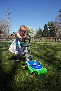 Capri giving the lawnmower a go