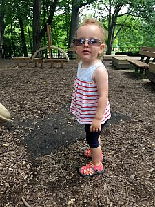 Wearing Mommy's sunglasses at the playground