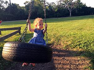 Having fun on the tire swing