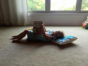 Capri reading to herself!