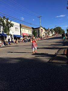 Capri walking down the street waiting for the Madeira 4th of July parade