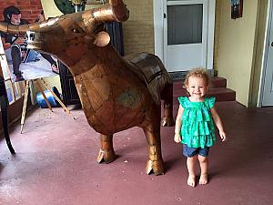 Kelly hanging with the cow-sculpted charcoal gfill