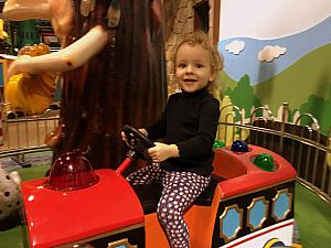 Riding a toy train ride