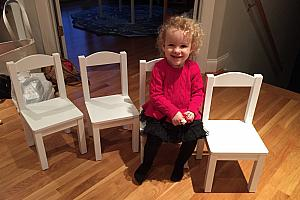 Capri modeling her new chairs :)