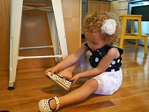 Putting on her shoes