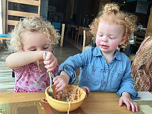 Capri and Kenley shared their food lots this week -- here they are eating spaaghetti and salmon out of the same bowl :)