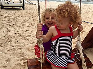 Capri pushing Kenley on the swing