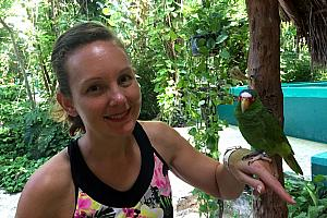 Visiting Crococun animal rescue zoo -- Kelly holding a birdie